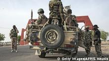 25.3.2016 *** Bildunterschrift:Soldiers of the 7th Division of the Nigerian Army prepare to leave Maiduguri in a heavily armed convoy on the road to Damboa in Borno State northeast Nigeria on March 25, 2016. On April 14, 2014, Boko Haram militants kidnapped 276 schoolgirls from their dormitories at the Government Girls Secondary School Chibok, drawing global attention to the Islamist insurgency in northeast Nigeria. / AFP / STEFAN HEUNIS (Photo credit should read STEFAN HEUNIS/AFP/Getty Images) Getty Images/AFP/S. Heunis