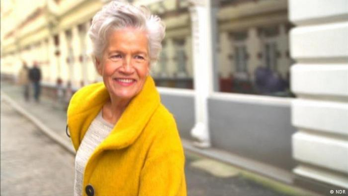 68-year-old Model Greta Silver posing for a photo-shooting on the street. (Picture: NDR)
