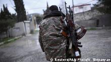 04.04.2016 ***** A soldier of the self-defense army of Nagorno-Karabakh carries weapons in Martakert province, which according to Armenian media was affected by clashes over the breakaway Nagorno-Karabakh region, April 4, 2016. REUTERS/Vahan Stepanyan/PAN Photo EDITORIAL USE ONLY. NO RESALES. NO ARCHIVE. TPX IMAGES OF THE DAY © Reuters/PAN Photo/V. Stepanyan