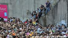 Attendees clambering up stairs at the 2010 Love Parade disaster