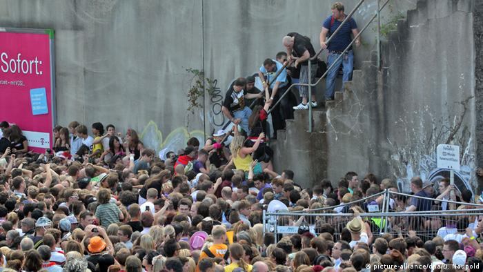 People clamber up stairs at the 2010 Love Parade disaster in Duisburg