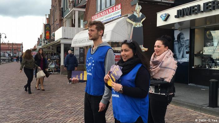 Acivists from the Dutch organization Geenpeil Hand out leaflets on the streets in the city of Volendam