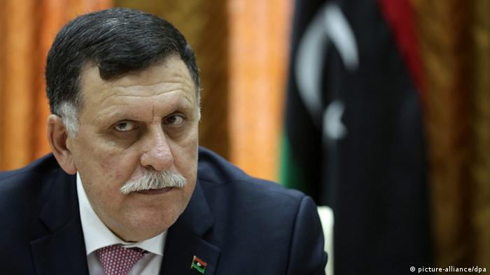 Libya's unity government's Prime Minister-designate Fayez al-Sarraj chairs a meeting of the presidential council with Tripoli municipal council in Tripoli, Libya, 31 March 2016