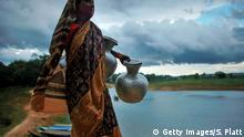 RANGAMATI, BANGLADESH - JULY 27: A woman arrives to retrieve water at a well July 27, 2008 in Rangamati in the Chittagong Hill Tracks region of Bangladesh. The Chittagong Hill Tracks is a tribal area of Bangladesh and was the scene of a guerrilla war from 1973 to 1997 between the Bangladeshi Army and tribal groups. Tensions from that period still linger in the Hill Tracks with numerous military checkpoints and garrisons. According to a recent World Bank study, Bangladesh is among at least 33 countries that are at risk of serious political unrest if food and fuel prices keep rising. Bangladesh is currently one of the world's poorest countries, where nearly 40 percent of the 144 million population survive on less than a dollar a day and on average spend eighty percent of their income on food. +++ (C) Getty Images/S. Platt