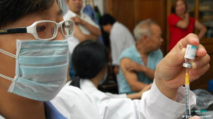 A medic in China prepares a H1N1 influenza vaccination for elderly residents in September 2009. (Getty Images/AFP)