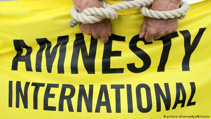 Amnesty international (picture-alliance/dpa/W.Kumm)