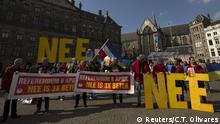 03.04.2016 *** Demonstrators call for people to vote no in the EU referendum during a protest at Dam Square in Amsterdam, the Netherlands April 3, 2016. The banners read: Referendum April 6. No is 3 times better, and the big letters collectively read No. REUTERS/Cris Toala Olivares © Reuters/C.T. Olivares