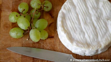 Camembert cheese with grapes Copyright picture- alliance/dpa/L.Halbauer