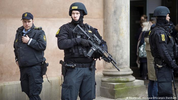 Armed Copenhagen police at the scene of one of the raids