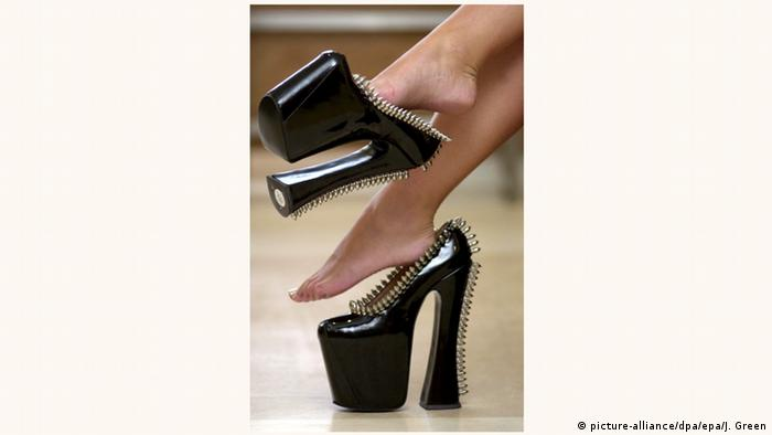 A pair of extremely high heels in black