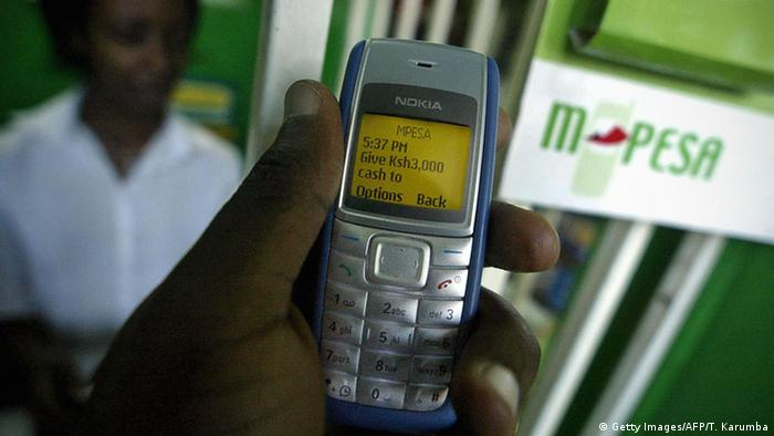 A mobile phone showing the M-Pesa system (photo: Getty Images/AFP/T. Karumba)