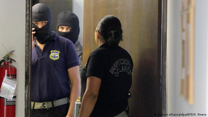 Agents of the National Civil Police of El Salvador raid a branch office of the Panamanian law firm Mossack Fonseca in San Salvador