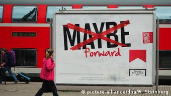 billboard advertising cigarettes with the word maybe in capital letters crossed out