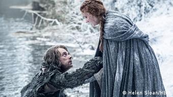 Alfie Allen as Theon Greyjoy and Sophie Turner as Sansa Stark Copyright: Helen Sloan/HBO