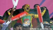 16.3.2016 *** Bildunterschrift:A Bangladeshi cricket fan in body paint shouts in support of the team during the World T20 match between Pakistan and Bangladesh at Eden Gardens in Kolkata on March 16, 2016. / AFP / ARINDAM DEY (Photo credit should read ARINDAM DEY/AFP/Getty Images) Getty Images/AFP/A. Dey