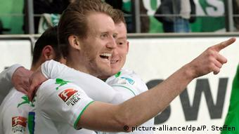 Andre Schürrle celebrates his goal for Wolfsburg in the club's 1-1 home Bundesliga draw with Mainz. Saturday, April 9, 2016.