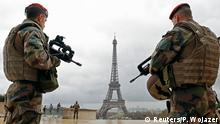 two soldiers near the Eiffel tower in Paris