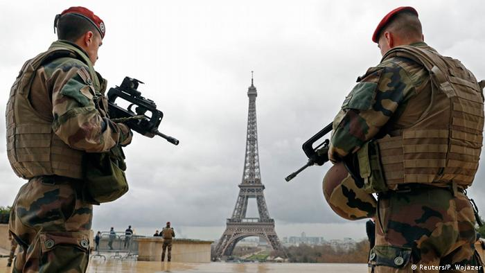 French army paratroopers patrol near the Eiffel tower