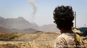 Rebel fighter in Yemen looks out over landscape