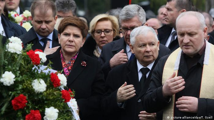 Prime Minister Beata Szydlo, and Law and Justice (PiS) leader Jaroslaw Kaczynski, and Senate Speaker Stanislaw Karczewski, pray at the memorial tomb for the victims of the plane crash near Smolensk during a ceremony marking the 6th anniversary of the crash in Warsaw.