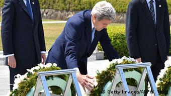 US Secretary of State John Kerry (C) offers a wreath at the Memorial Cenotaph for the 1945 atomic bombing victims in the Peace Memorial Park, on the sidelines of the G7 Foreign Ministers' Meeting in Hiroshima on April 11, 2016