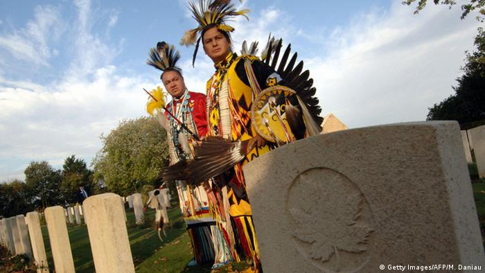 Indigenous Canadians at a memorial site