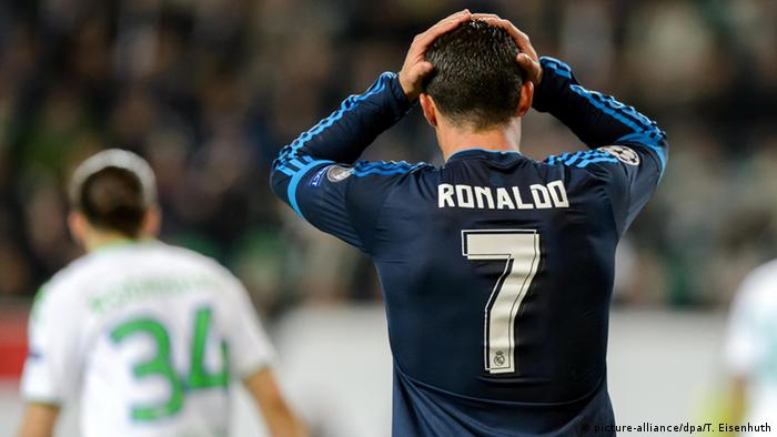 Champions League: VfL Wolfsburg - Real Madrid --- Cristiano Ronaldo (foreground, back to camera) holds his hands to his head during Real Madrid's 2-0 defeat to Wolfsburg.