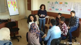 Citizen journalist trainees practise a mock empathy interview