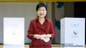 South Korean President Park Geun-hye stands next tot he ballot box before casting her vote.