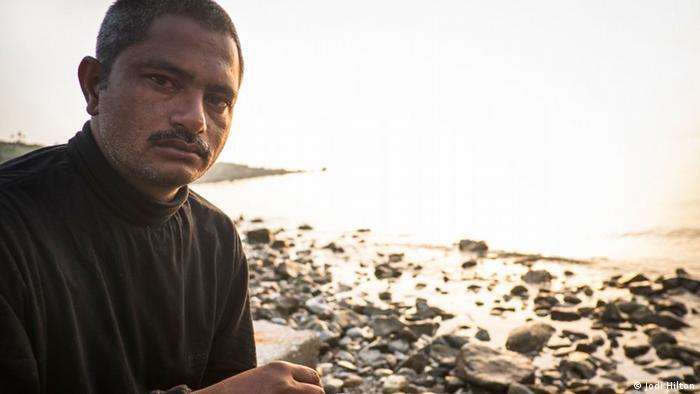 Ijaz sits on a beach on Lesbos