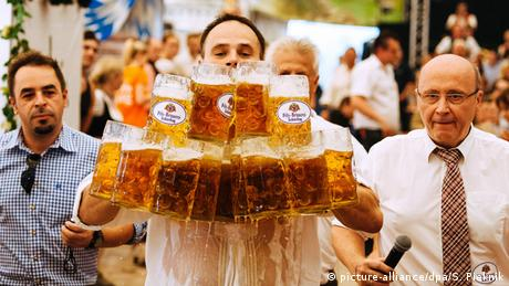 A man carrying 27 beer glasses