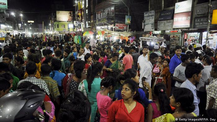 People crowd onto the street during an earthquake in Agartala, capital of India's northeastern state of Tripura