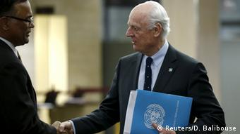UN mediator Staffan de Mistura (R) arrives for a meeting with the delegation of the High Negotiations Committee (HNC) during Syria Peace talks at the United Nations in Geneva, Switzerland, April 13