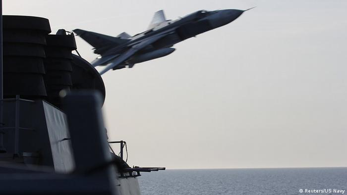 A Russian fighter jet comes within 10 meters of the deck of the USS Donald Cook, during a flyby incident in the Baltic Sea.
