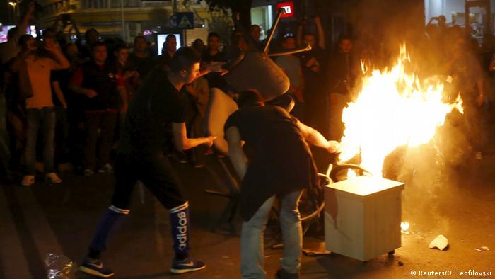 Protesters in Skopje set furniture from the presdient's office alight.