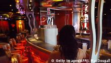 Berlin, GERMANY: FILES - A sex worker poses at the bar of Berlin's Artemis brothel 04 May 2006. Artemis, the largest brothel in Berlin, boasts 4 storeys, 70 rooms, 3 saunas, 2 small movie theatres, a pool and a fitness centre. It is located close to Berlin Olympiastadion, which will be hosting 6 FIFA 2006 Football World Cup matches. After months of warning that the football World Cup 2006 would see an explosion in forced prostitution, German police said 09 June 2006 there were no signs that this was happening. +++ (C) Getty Images/AFP/J. MacDougall
