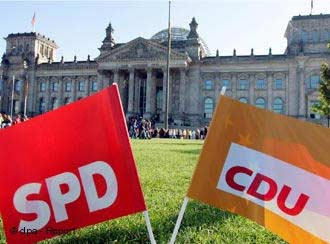 SPD and CDU flag in front of German parliament