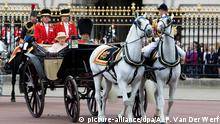 Britain's Queen Elizabeth II and her husband Prince Philip travelling in an open state carriage from Buckingham Palace to nearby Horse Guards Parade in central London 13 June 2015 to attend the traditional Trooping the Colour ceremony which marks the monarch's official birthday. Photo: Albert Philip van der Werf/RPE/NETHERLANDS OUT Copyright: picture-alliance/dpa/A. P. Van Der Werf