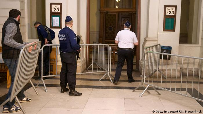Police security officers stand guard at the entrance of the appeal court of Brussels, in the case of Khalid Zerkani, jihadist recruiter