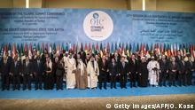 14.04.2016 Turkish President Recep Tayyip Erdogan (C) poses for a family photo with the leaders of participating countries during a family photo of 13th Organization of Islamic Cooperation (OIC) Summit at Istanbul Congress Center (ICC). Turkish President Recep Tayyip Erdogan on Thursday hosts over 30 heads of state and government from Islamic countries in Istanbul for a major summit aimed at overcoming differences in the Muslim world. Turkey seeks to showcase its influence in the Muslim world, particularly in lands once controlled by the Ottoman Empire, at the two-day summit of the Organisation of Islamic Cooperation (OIC). / AFP / OZAN KOSE (Photo credit should read OZAN KOSE/AFP/Getty Images) Copyright: Getty Images/AFP/O. Kose