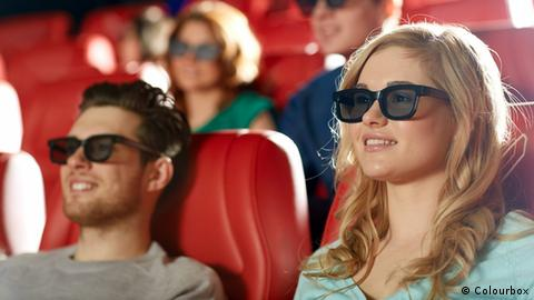 People with 3D glasses at the cinema, Copyright: Colourbox
