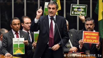 General Attorney Jose Eduardo Cardozo argues against impeachment, raising he right arm, in the lower house of Congress.