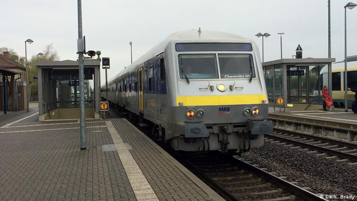 Yellow MRB train standing at station