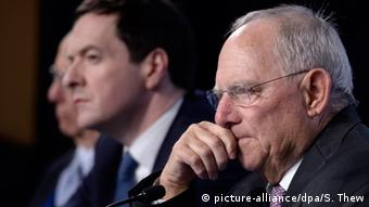 German Finance Minister Wolfgang Schaeuble (R), with British Chancellor of the Exchequer George Osborne (L), participates in a press conference