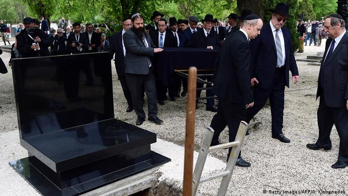 The remains of Hungarian Jews believed shot into the Danube river during World War II were buried in Budapest ATTILA KISBENEDEK/AFP/Getty Images