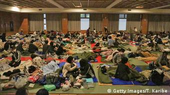 People get up right after the 7.3 magnitude earthquak at the evacuation center at the Mashiki Town Gymnasium on April 16, 2016 in Mashiki, Kumamoto, Japan Photo by Taro Karibe/Getty Images