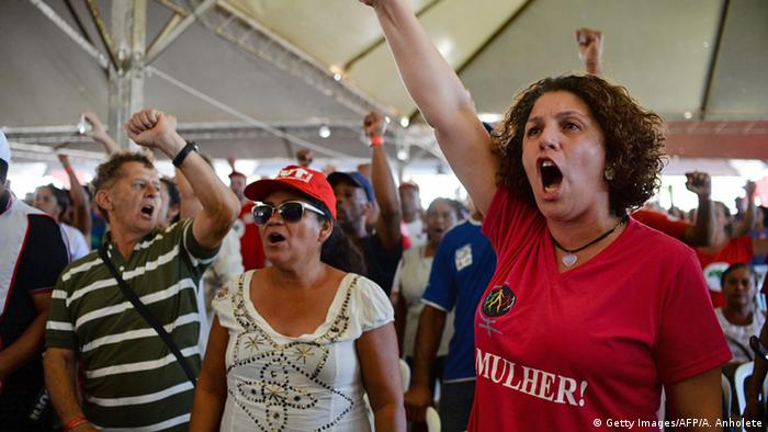 Rousseff supporters shout and raise their fists to demonstrate against her impeachment.