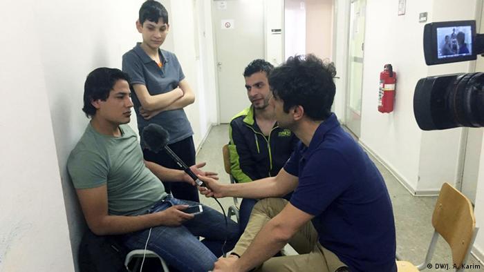 Jaafar Abdul Karim interviews a refugee in Berlin