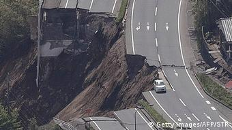 The aerial view shows a collapsed road after an earthquake in Minami-Aso, Kumamoto prefecture
