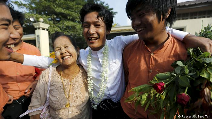 A student activist (2nd R) and his family celebrate outside the prison after he was released by the new government's general amnesty in Yangon, Myanmar April 17